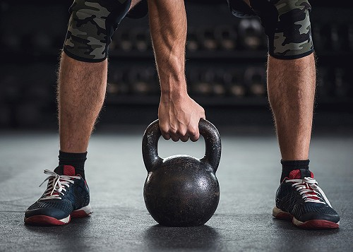 A man using a kettle bell